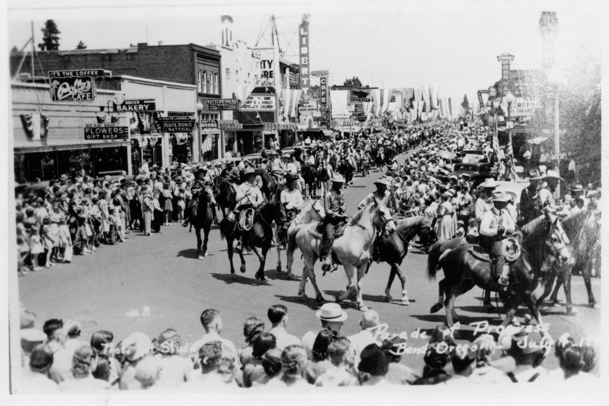 Horsebacked riders stroll through downtown circa 1940. (Note the Tower and Liberty theaters in the background.)