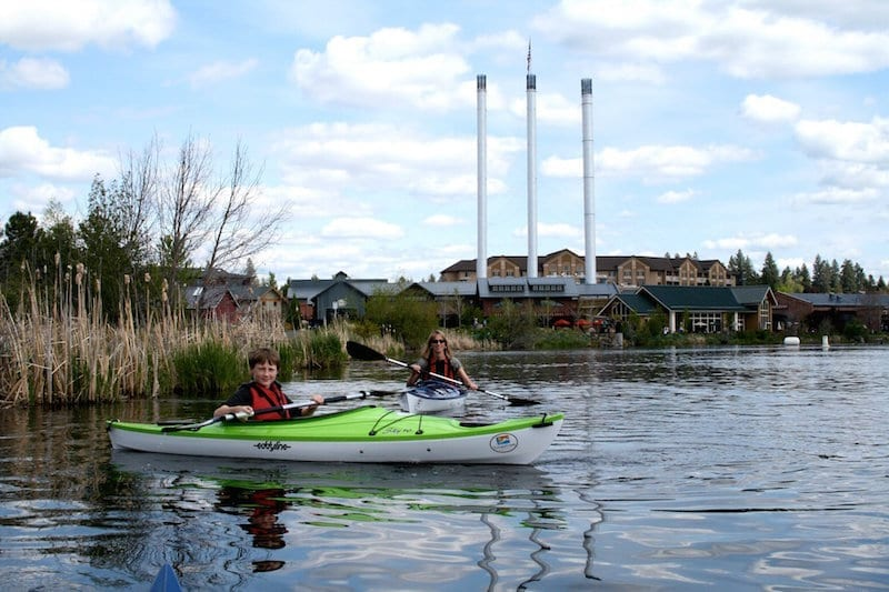 Family kayaking adventure on the Deschutes River in Bend's Old Mill District.