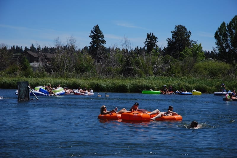 Families floating the Deschutes RIver in Bend, Oregon.