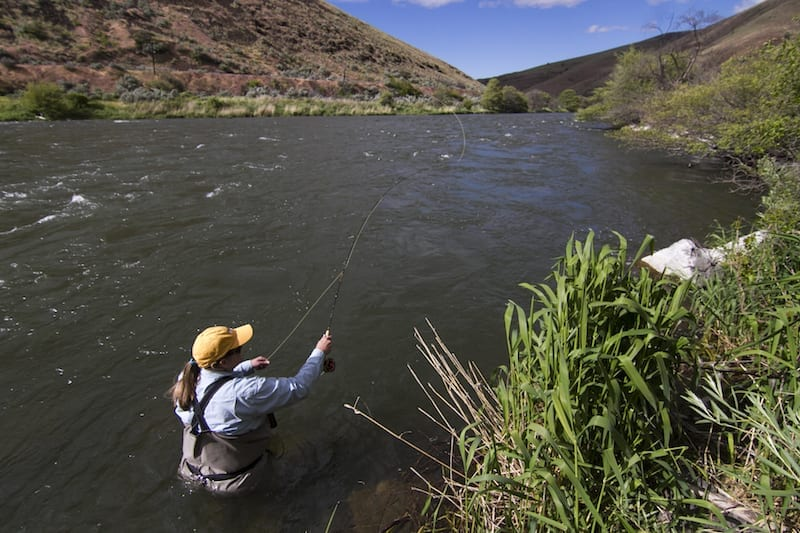 Amy Hazel casts her fly-fishing rod on the Deschutes River in Maupin, Oregon.