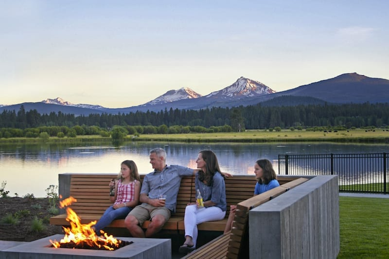 Family sitting around the fire at Black Butte Ranch in Sisters, Oregon.