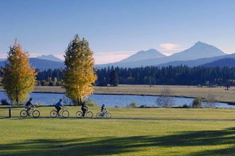Family biking along the trails in Black Butte Ranch in Sisters, Oregon.