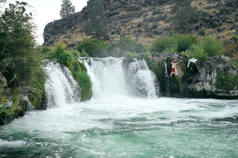 Cliff jumping at Steelhead Falls in Central Oregon