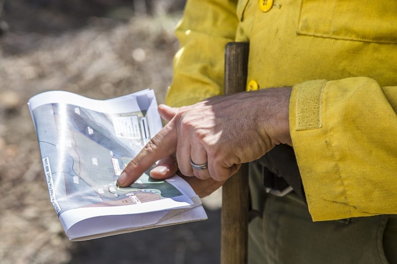 A firefighter works on a prescribed burn in Central Oregon