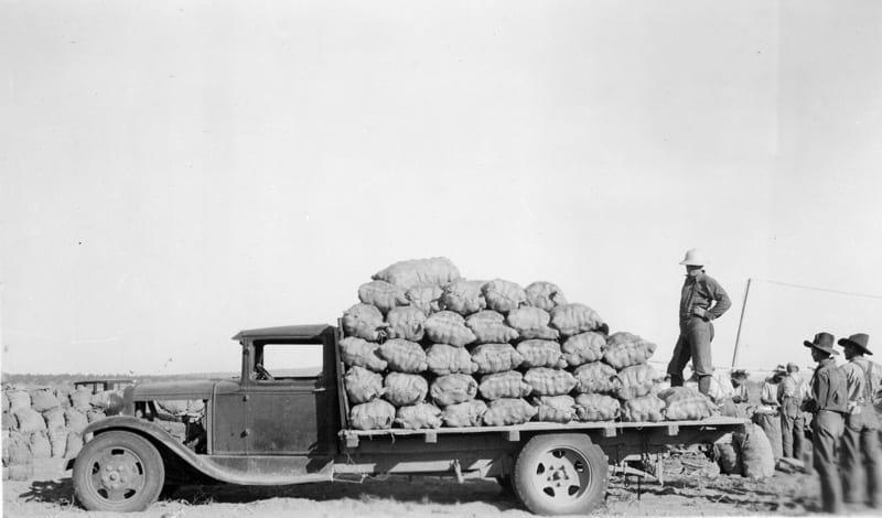 Historic photo of truck loaded with potatoes grown in Central Oregon.
