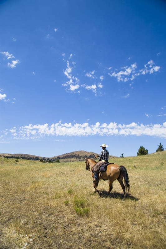 Horseback riding at Wilson Ranches Retreat in Fossil, Oregon.