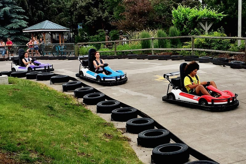 Families race around the go-kart at Sun Mountain Fun Center in Bend.