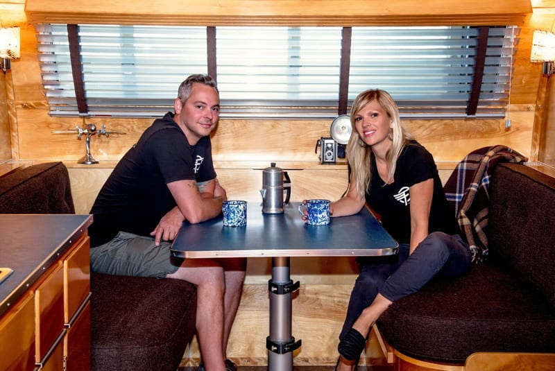 Justin and Anna Scribner sit in the Neutron, Flyte Camp's new model of vintage-inspired camping trailers.