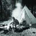 Historical icon Paul Hosmer beside his tent in Bend, Oregon