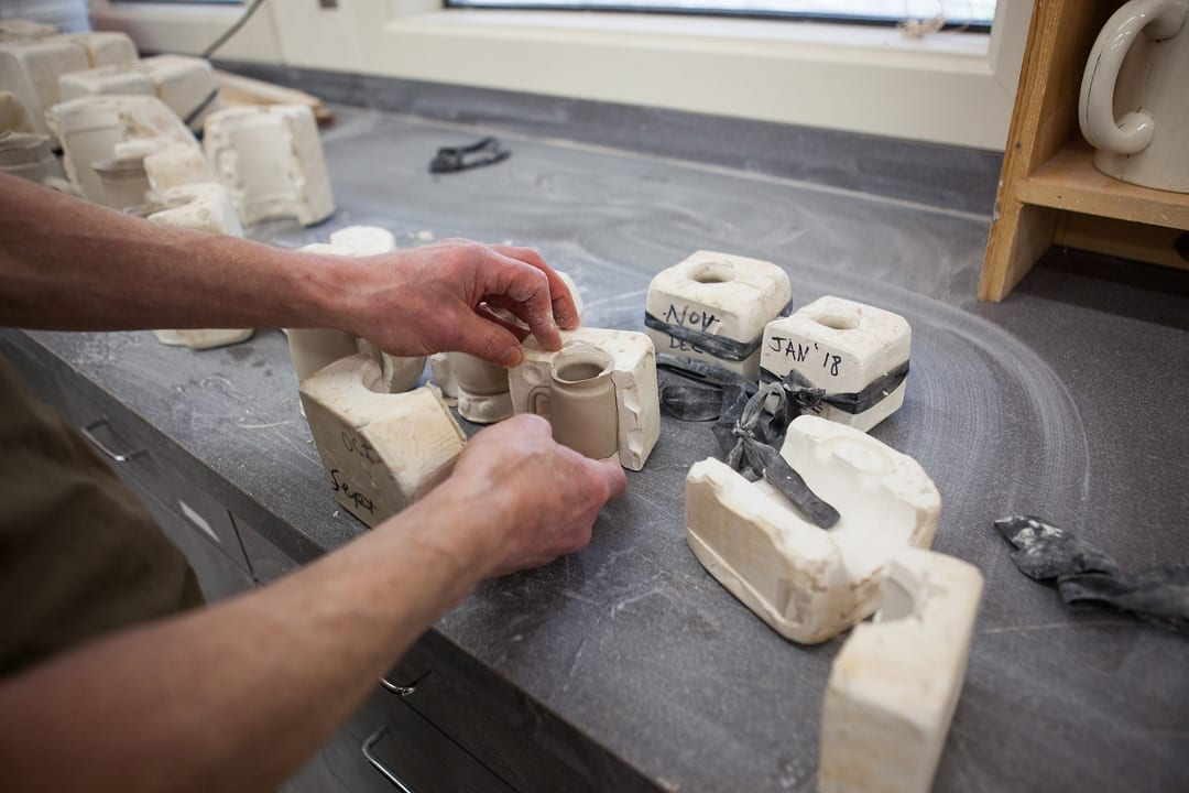Installation artist Bill Cravis uses clay in Bend, Oregon